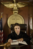 Female Judge Referring To Law Book — Stock Photo