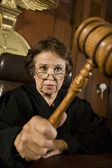 Female Judge Knocking Gavel — Stock Photo