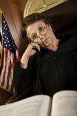 Pensive Judge Sitting In Court — Stock Photo