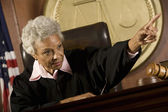 Judge Pointing In Courtroom — Stock Photo