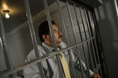 Criminal Behind Bars In Jail — Stock Photo