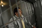 在监狱的铁窗刑事 — 图库照片