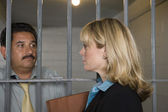 Lawyer With Criminal Behind Bars — Stock Photo