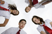 Happy High School Students Looking Down — Stock Photo