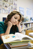 Female Student Reading Book In Library — Stock Photo