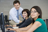Female Students With Professor In Computer Lab — Stock Photo