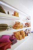 Pillows Displayed On Shelves — Stock Photo
