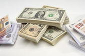 Stack of US, British and European Currency — Stock Photo