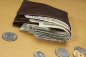 Wallet Full Of Money And Coins On Table — Stock Photo