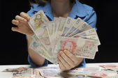 Woman With Fan Of Pound Currency Notes — Stock Photo