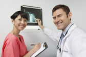 Friendly Medical Staff Members With X-Ray Results — Stock Photo