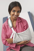 Portrait Of Young Woman With Arm In Sling — Stock Photo