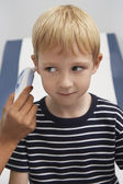 Boy Having Temperature Taken With Ear Thermometer — Stock Photo