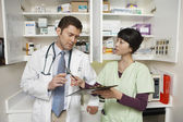 Doctor With Female Assistant — Stock Photo