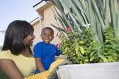 Woman And Son Tending Plants — Stock Photo