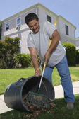 Man Raking Leaves In Garden — Stock Photo