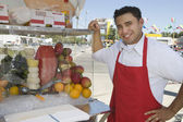 Street Vendor Standing By Stall — Stock Photo