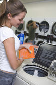 Woman At Launderette — Stockfoto