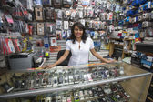 Female Owner Standing In Mobile Shop — Stock Photo