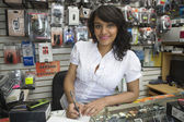 Female Owner Making Bill At Mobile Store — Stock Photo