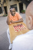 Senior Male Friends Playing Chess — Stock Photo