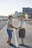 Senior Couple On Promenade Holding Hands — Stock Photo