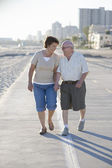 Senior Couple On Footpath Along Beach — Stock Photo