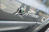 Sign on hybrid car — Stock Photo