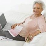 Senior Woman Paying Bills Online — Stock Photo