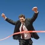 Businessman Crossing The Finish Line — Stock Photo