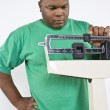 Man Adjusting Weight Scale At Clinic — Stock Photo