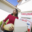 Bankrupt Woman Moving Out Of House — Stock Photo