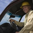 Senior Man In Truck At Wind Farm - Stock Photo