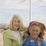 Senior Couple With Backpack Near Wind Farm — Stock Photo #22151409
