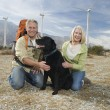 Senior Couple With Dog Near Wind Farm — Stock Photo #22151425