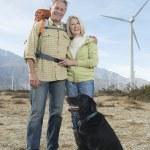 Senior Couple With Dog Near Wind Farm — Stock Photo #22151427