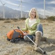 Stock Photo: Senior WomWith Hiking Pole And Backpack At Windfarm