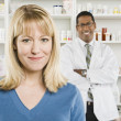 Pretty Woman And Pharmacist At Pharmacy — Stock Photo
