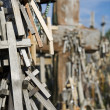 Wooden Crosses Hanging On Tombstone — Stock Photo