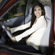 Portrait of a woman taking a test drive - Stock Photo