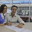 Couple signing documents for new car — Stock Photo