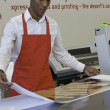 Stock Photo: Industrial manual worker working in printing press