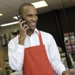Industrial worker talking on phone — Stock Photo