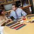 salesperson showing color samples to female client — Stock Photo #22153111