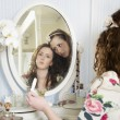 Sisters at dressing table — Stock Photo #22154187