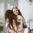 Portrait of young woman hugging her sister — Foto Stock