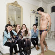 Royalty-Free Stock Photo: Male stripper performing in front of young females