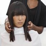 Asian woman getting a new haircut at beauty salon — Stock Photo