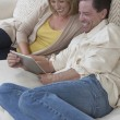 Royalty-Free Stock Photo: Happy Couple Using Digital Tablet