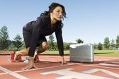 Businesswoman At The Starting Blocks With Briefcase — Stock Photo